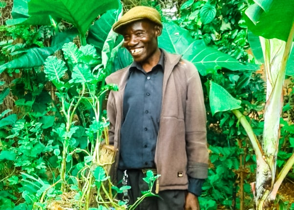 """Chief Bito loves experimenting in his garden. In 2018, he grew acacia trees. Less than 10 months later, he tell us """" I sold 6 ox carts of wood worth nearly $60. And I still have the trees!"""""""