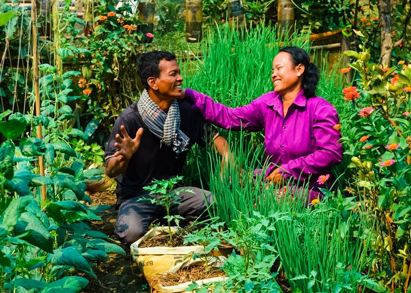 Chun Sim and her husband Seang Samet live in Sdok Chum village in Cambodia and are both farmers by trade.   Seang urged his wife to join the Campaign knowing her passion for gardening and interest in learning about permaculture practices. By October 2018 Chun had created her very first victory garden.  Her garden was 8m x 4m in size and contained Chinese radish, green mustard, long bean, and cucumbers. After only a few months many more vegetables were added into the rotation and it now has 5 kind of herbs including basil, rice paddy herbs, frog leg, green onion, water dropwort, chinese chives, green mustard, saw leaf, ginger, turmeric, galangal root, Ttaro, chili, kale, chinese radish, morning glory, sponge gourd, eggplant, bok choy, and elephant ear.   Chun has learned several planting techniques and using a variety of containers has planted:  Bamboo Circle Gardens, in which a variety of vegetables can be planted and due to it's small size can retain water, especially during the dry season  Foam Container Gardens, which are portable, conserve water and space, and can be used in either the rainy or dry seasons Palm Frond Container Gardens, Water Buckets, and Plastic Bottles.  Benefits From The Garden: Every month Chun and Seang have enough healthy food, free of pesticides and chemical fertilizers, for their family to eat, and are able to sell around $150 worth of surplus vegetables.