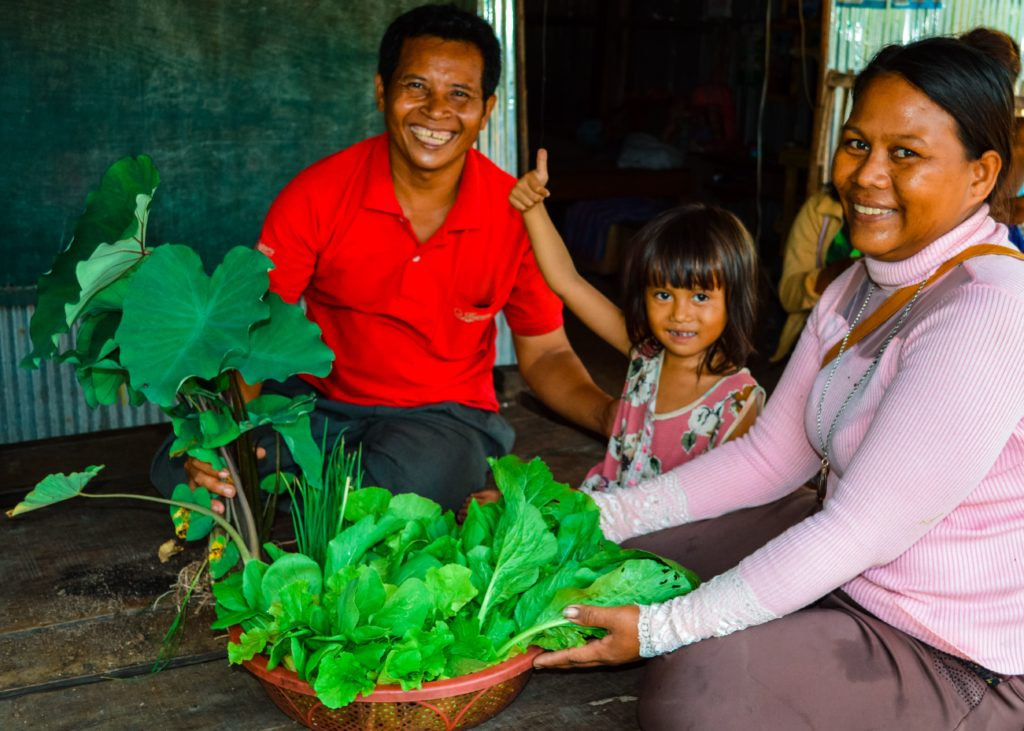 A year ago, Yern had almost nothing in his garden. Polio made construction or rice field labor impossible, so life for he and his wife was so difficult. Today, we counted a whopping 60 kinds of plants and trees in his victory garden. He sells produce every day, and he and his family are very happy.